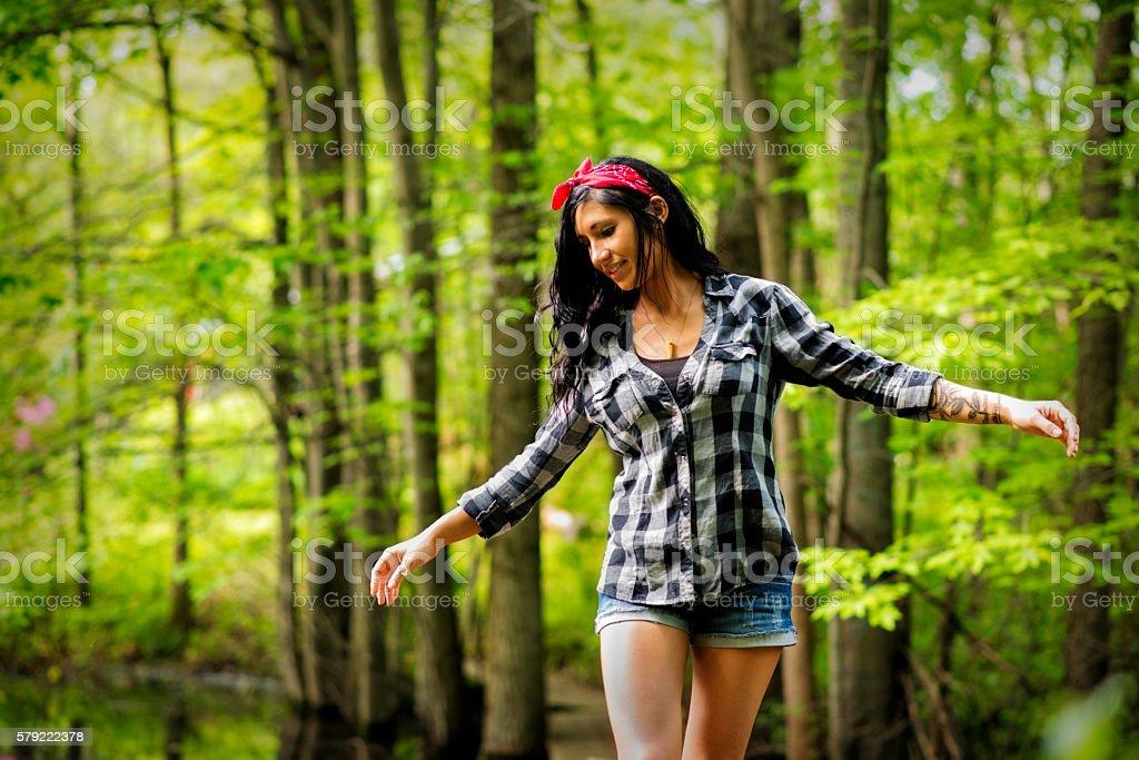 Pretty Brunette Enjoying Moments in Nature stock photo