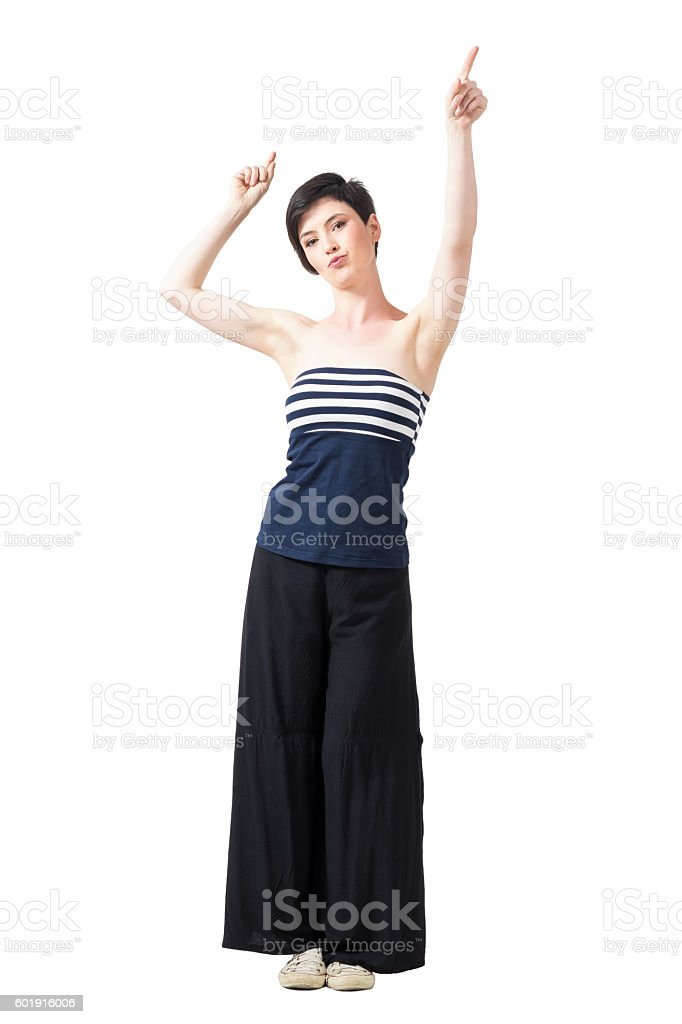 Pretty brunette in off shoulder top with raised arms stock photo