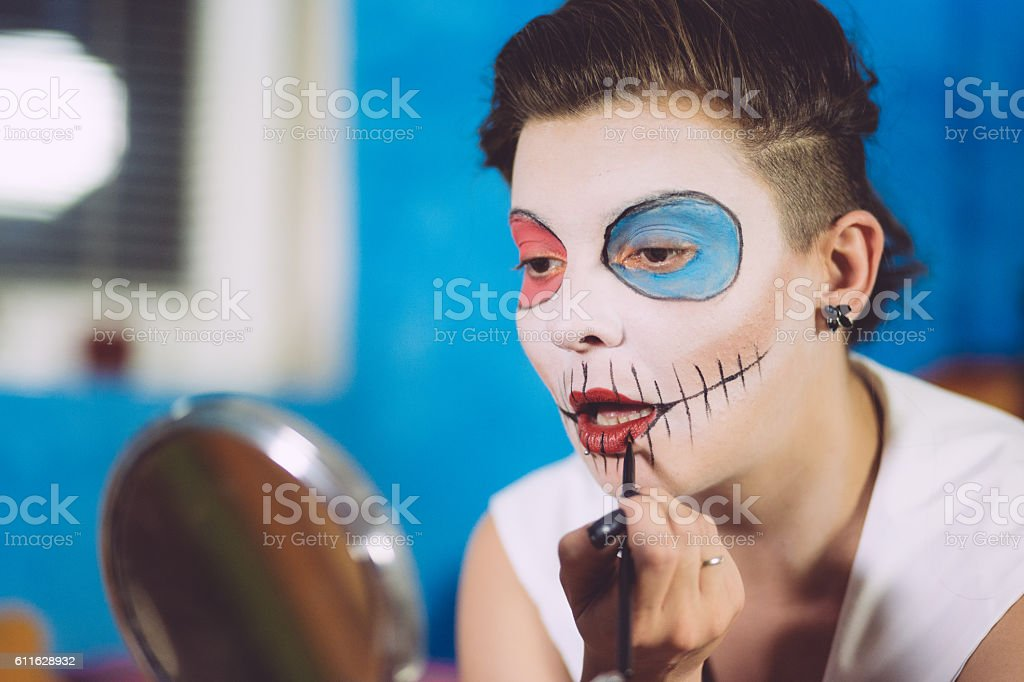 Pretty Brunette Making Up For Helloween stock photo