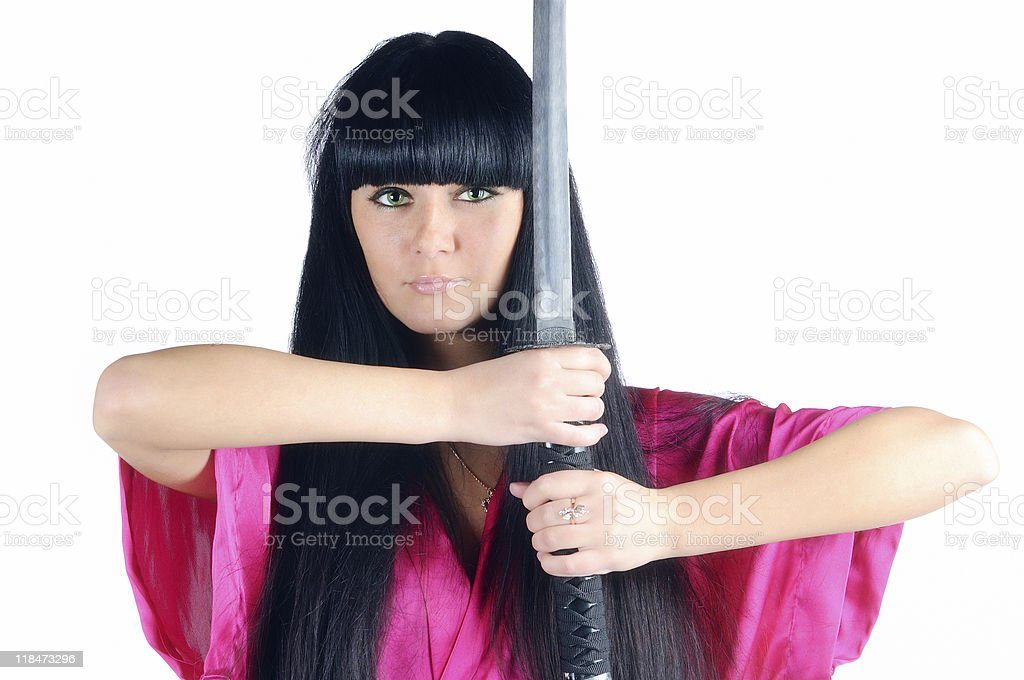 pretty brunette ninja royalty-free stock photo