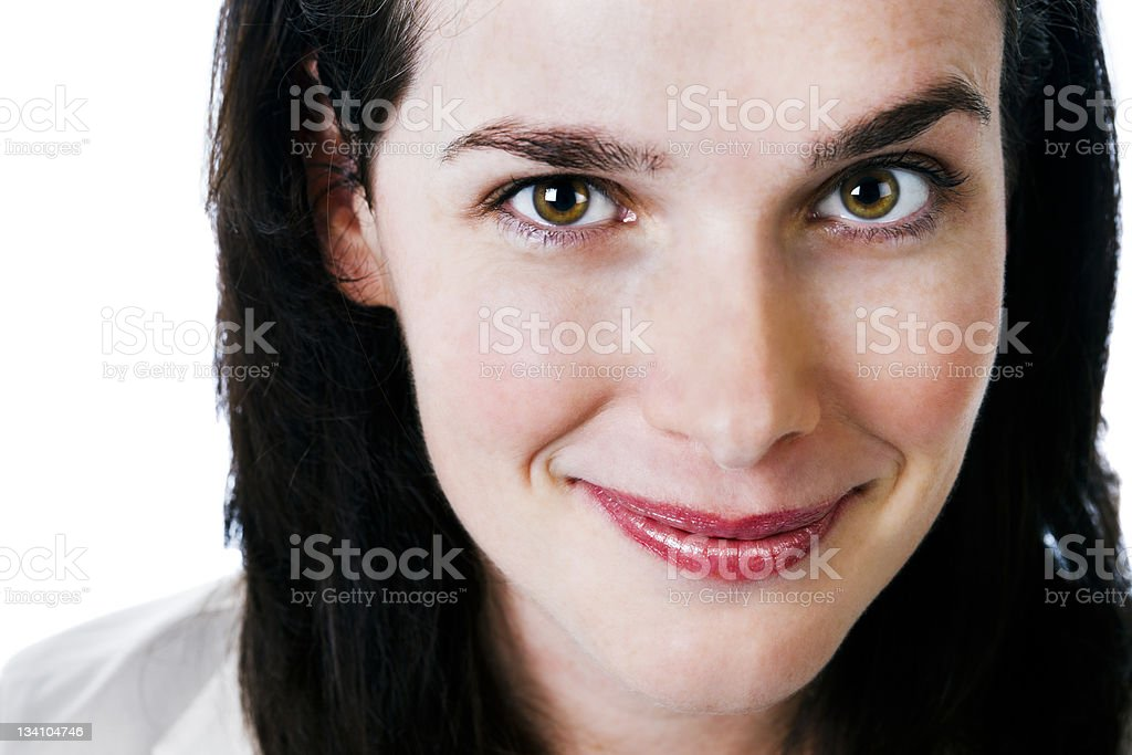 Pretty brunette smiles at camera royalty-free stock photo