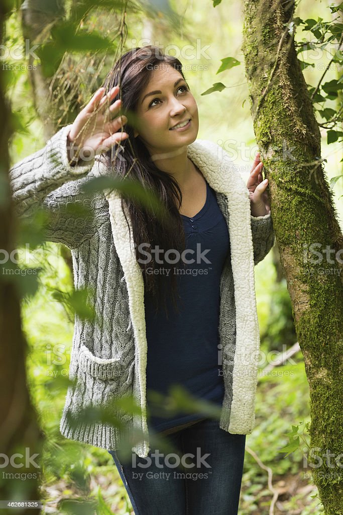 Pretty brunette strolling in a green forest royalty-free stock photo