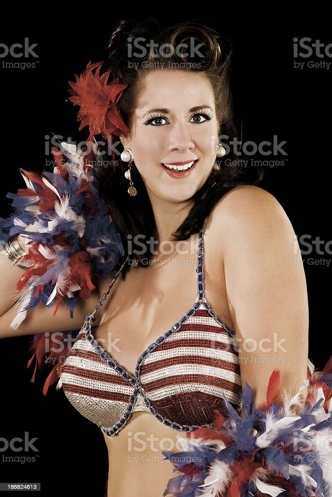 Pretty burlesque performer with red white and blue feathers royalty-free stock photo