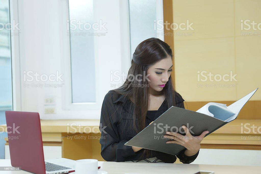 Pretty business lady working at desk royalty-free stock photo