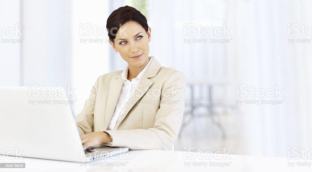 Pretty business woman using laptop royalty-free stock photo