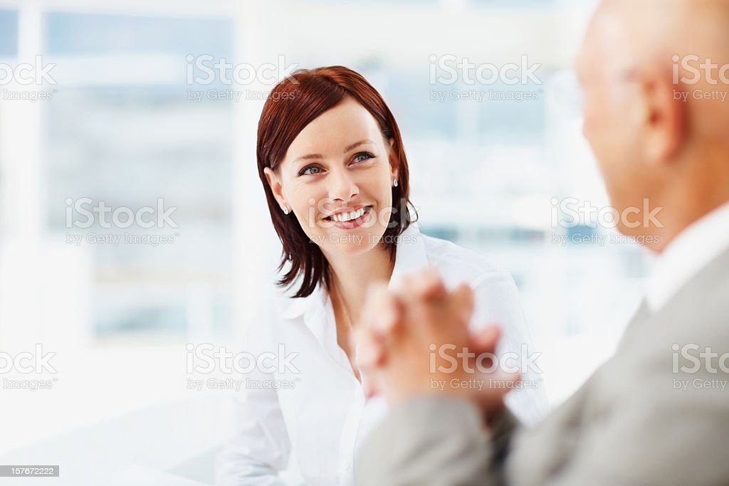 Pretty business woman with a blur senior man at office royalty-free stock photo
