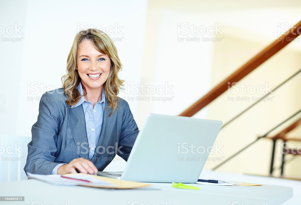 Pretty business woman working on laptop royalty-free stock photo