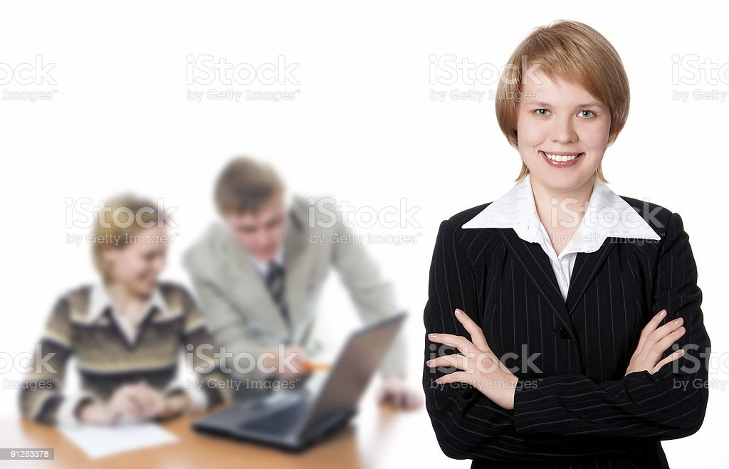 Pretty businesswoman and business team royalty-free stock photo