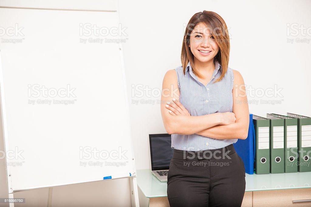 Pretty businesswoman giving a presentation stock photo