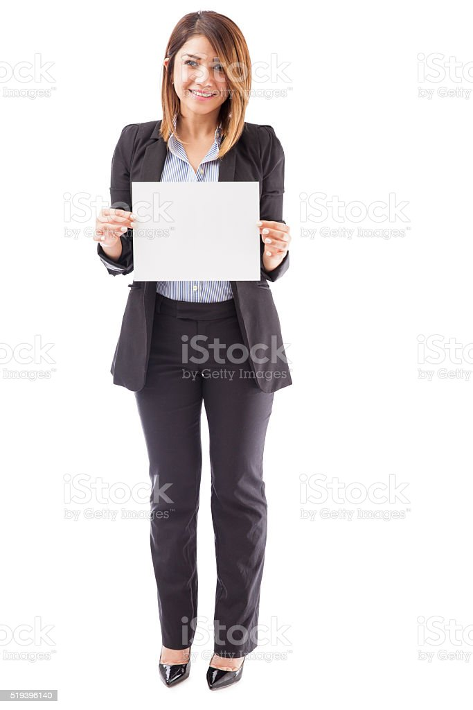 Pretty businesswoman holding up a sign stock photo
