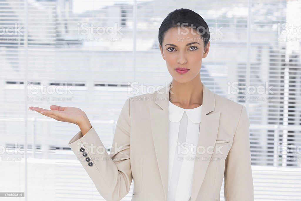 Pretty businesswoman opening her hand royalty-free stock photo