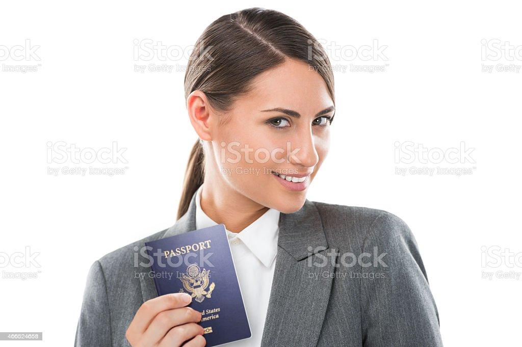 Pretty businesswoman thinking about her next destination stock photo