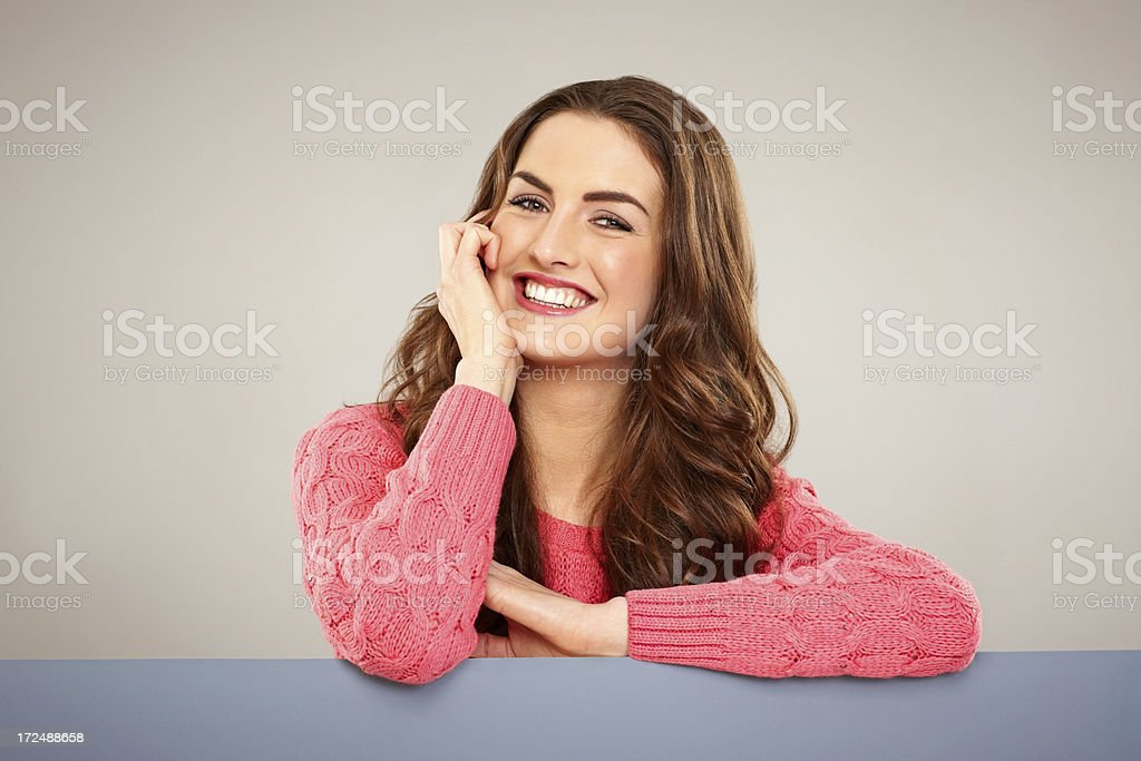 Pretty casual female above empty banner smiling royalty-free stock photo