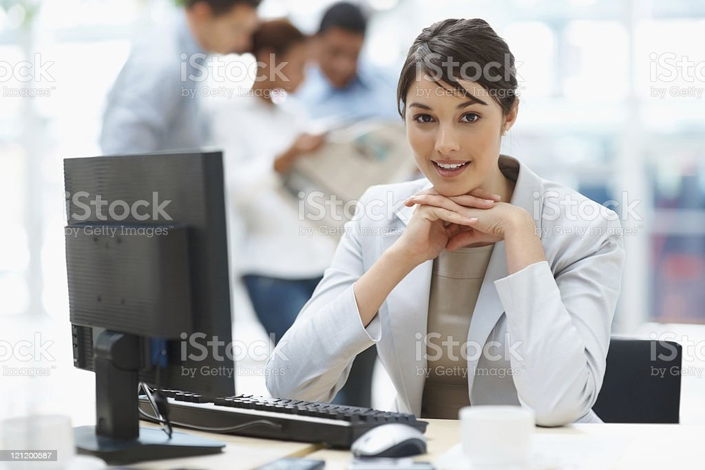 Pretty Caucasian business woman at office desk royalty-free stock photo