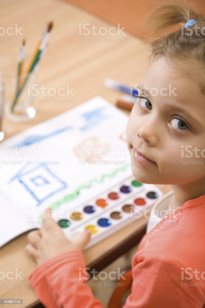 Pretty caucasian child paint watercolor royalty-free stock photo