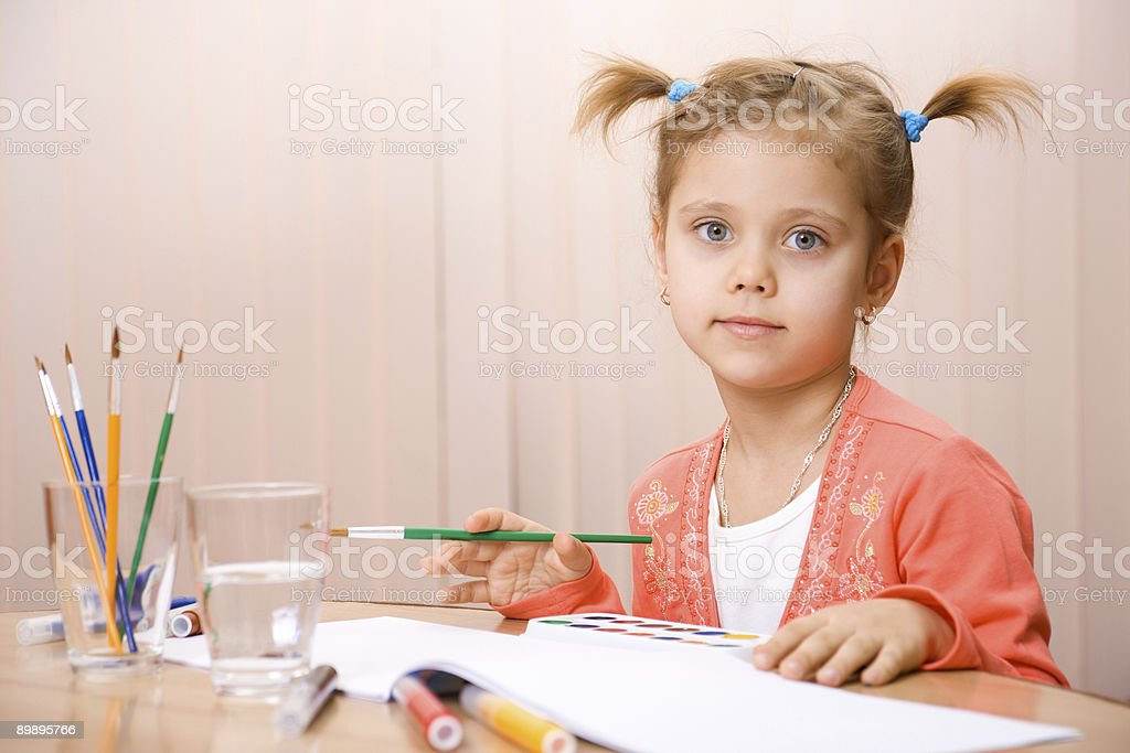 Pretty caucasian child watercolor paint royalty-free stock photo