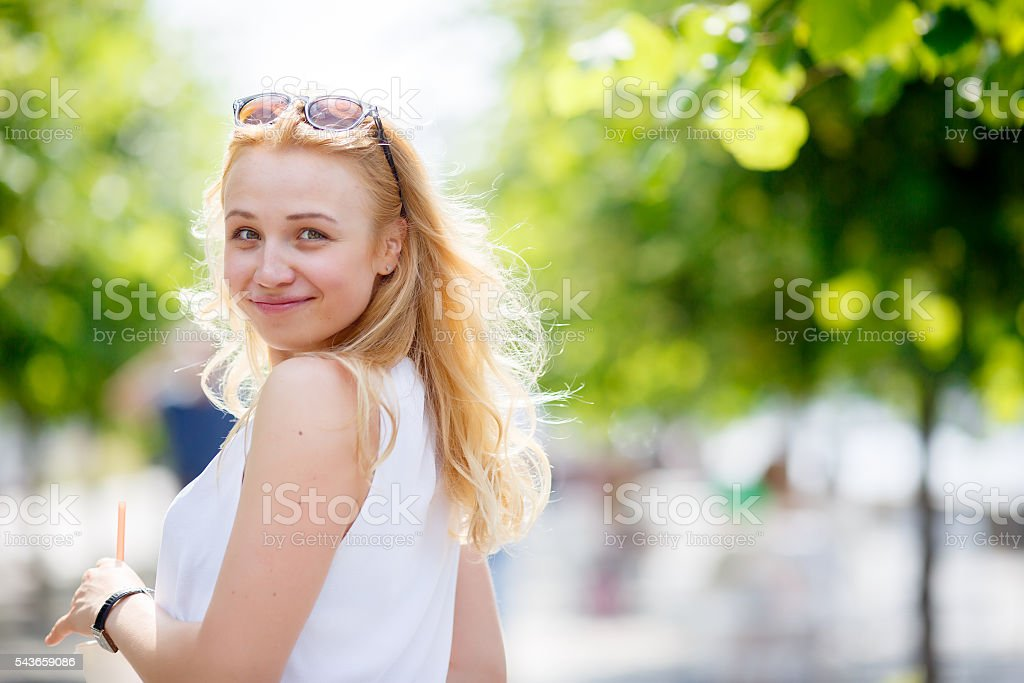 Pretty caucasian girl glance back stock photo