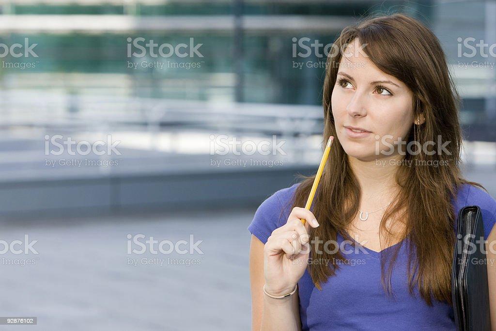 Pretty caucasian girl pondering or thinking stock photo
