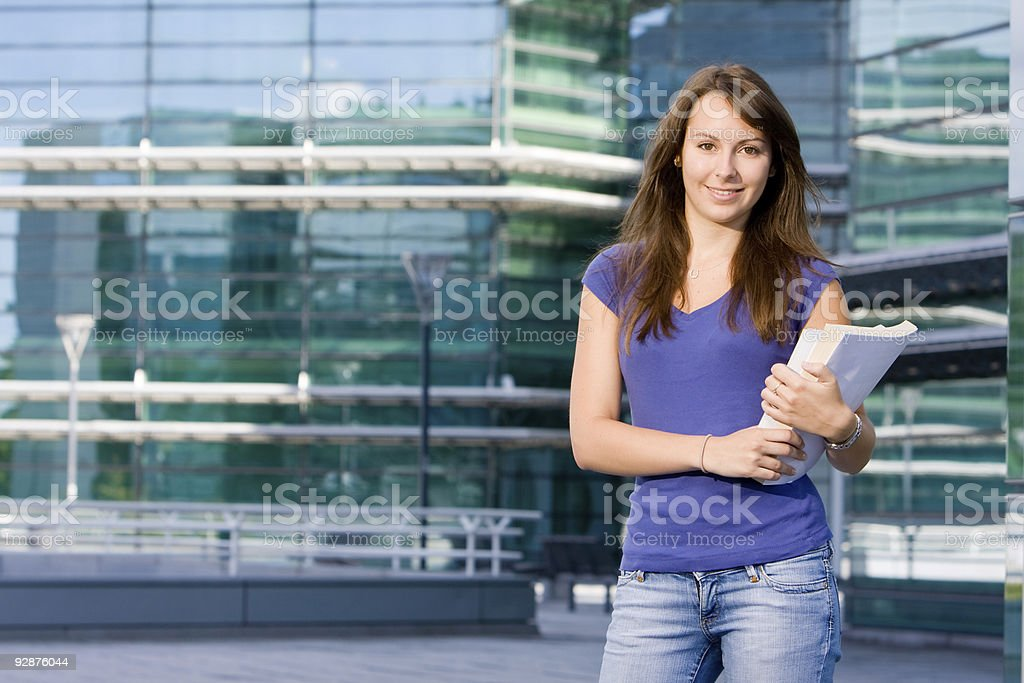 Pretty caucasian girl standing in school royalty-free stock photo