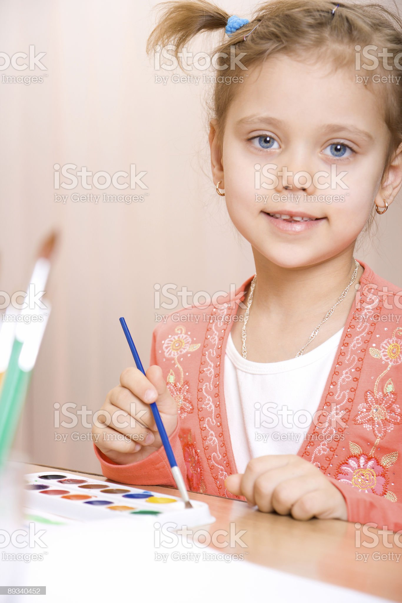Pretty caucasian girl watercolor paint and look in camera royalty-free stock photo