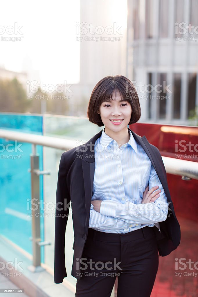 pretty chinese girl outdoors stock photo