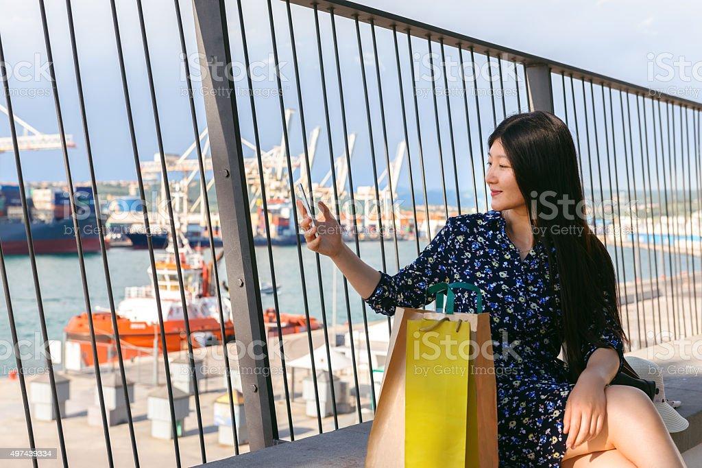 Pretty Chinese Tourist Taking Selfie while Visiting Europe, Koper, Slovenia stock photo