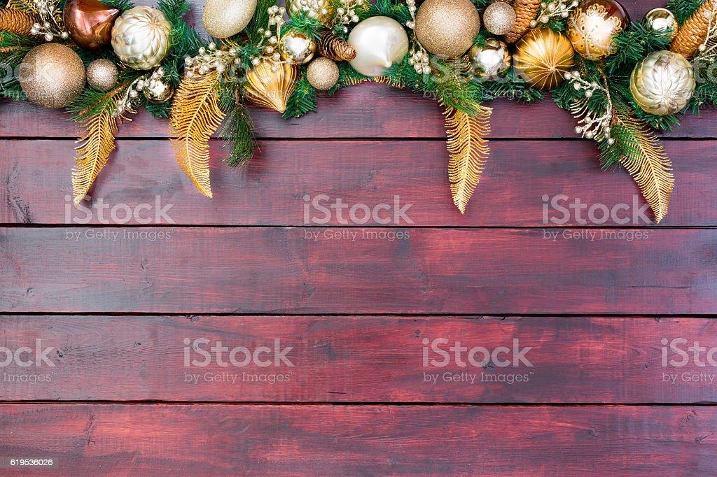 Pretty Christmas border wreath atop wood stock photo
