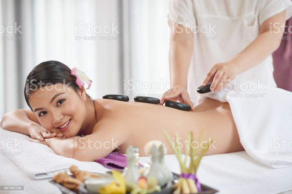Pretty Client Enjoying Stone Massage stock photo