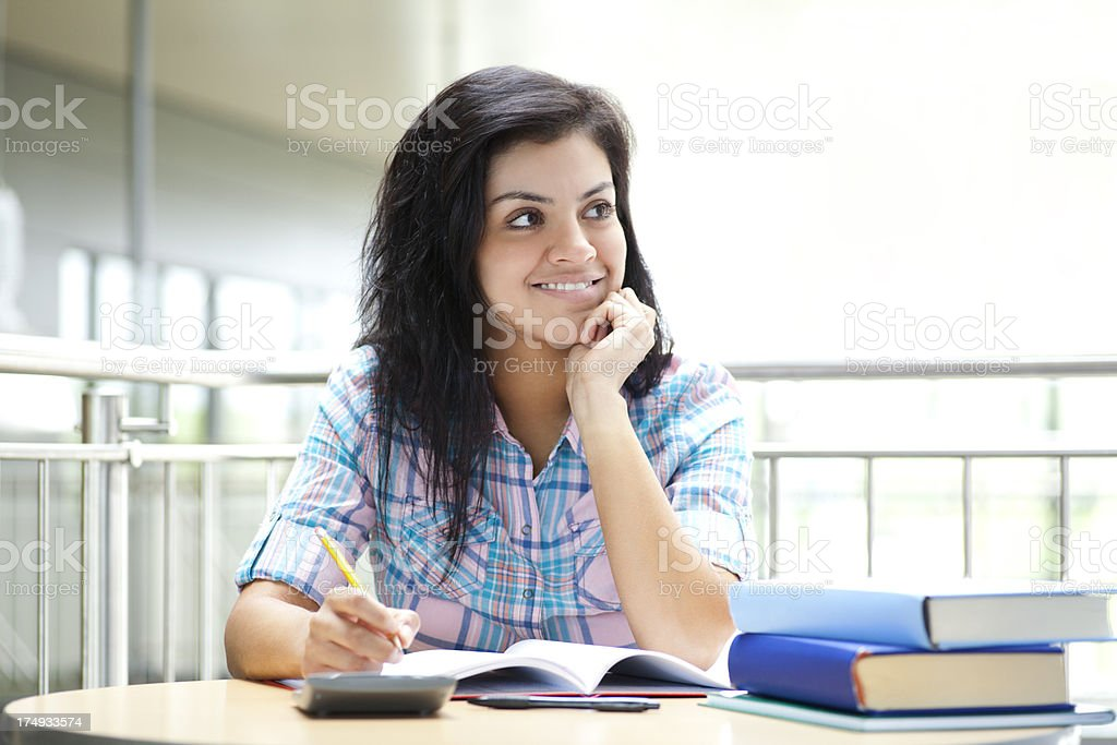 Pretty college student doing homework royalty-free stock photo