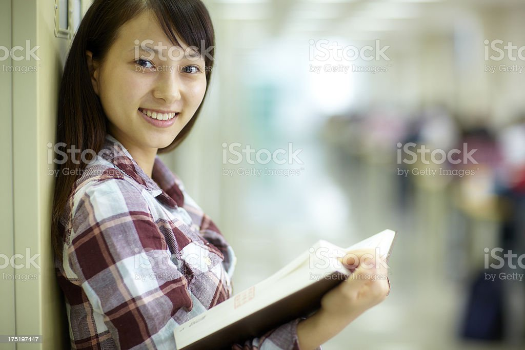 pretty college student in the library royalty-free stock photo