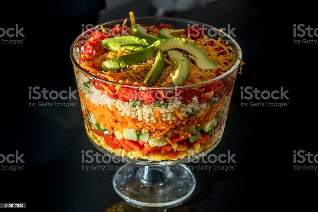 Pretty Colorful Layered Salad in a Glass Trifle Bowl stock photo