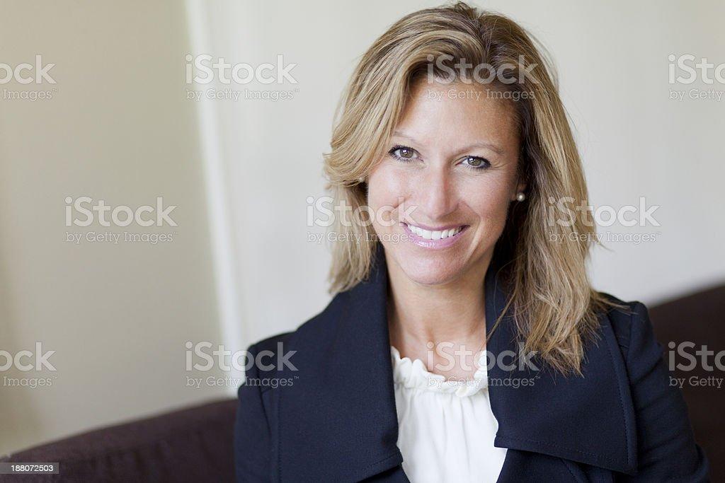 Pretty Confident businesswoman at home stock photo