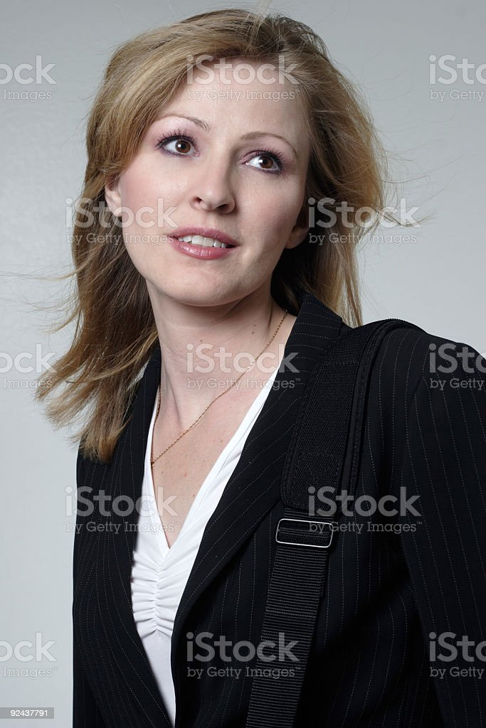 Pretty Corporate Woman looking up stock photo