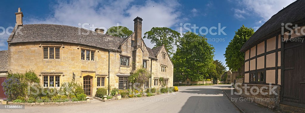 Pretty country village stone cottages royalty-free stock photo