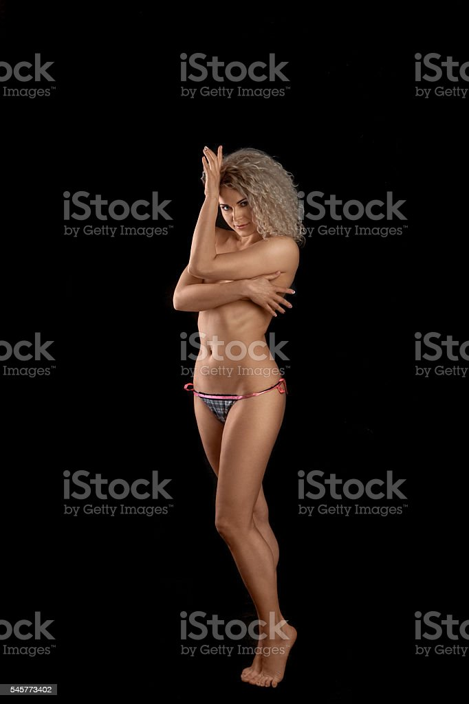 Pretty curly blonde looking at the camera stock photo