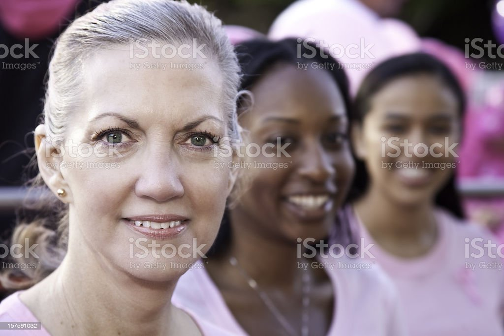 Pretty Diverse Group of Women wearing Pink in a row royalty-free stock photo