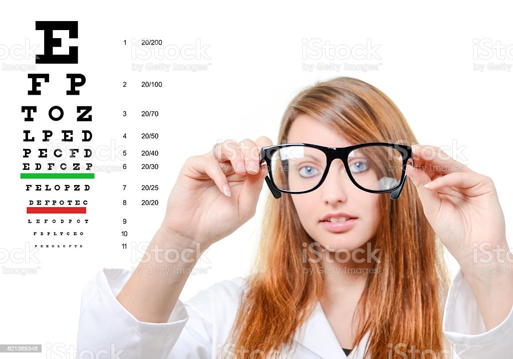 Pretty doctor portrait with glasses in her hand stock photo