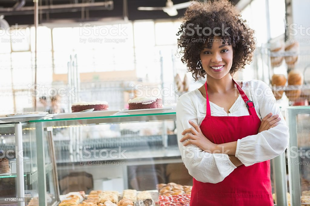 Pretty employee posing with arms crossed stock photo