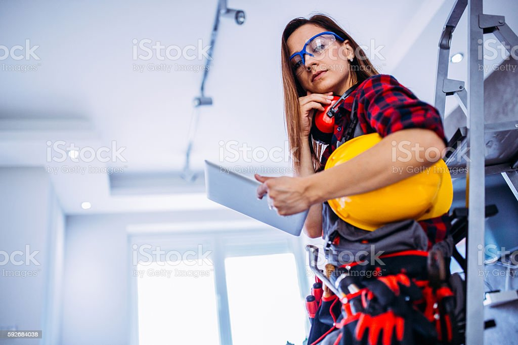 Pretty engineer girl with tablet stock photo
