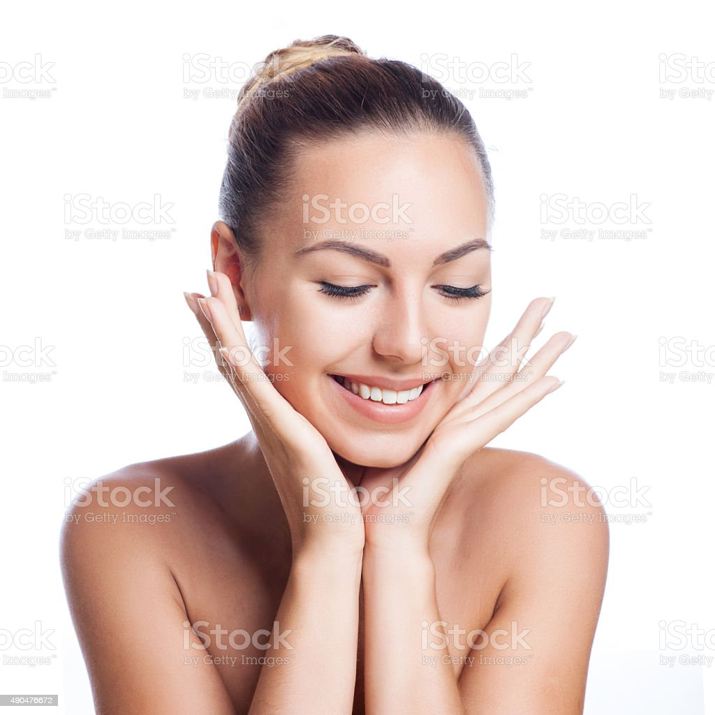 Pretty face of beautiful smiling woman - isolated on white stock photo