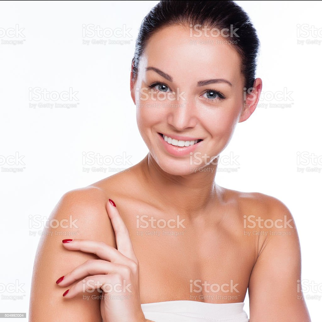 Pretty face of beautiful smiling woman stock photo