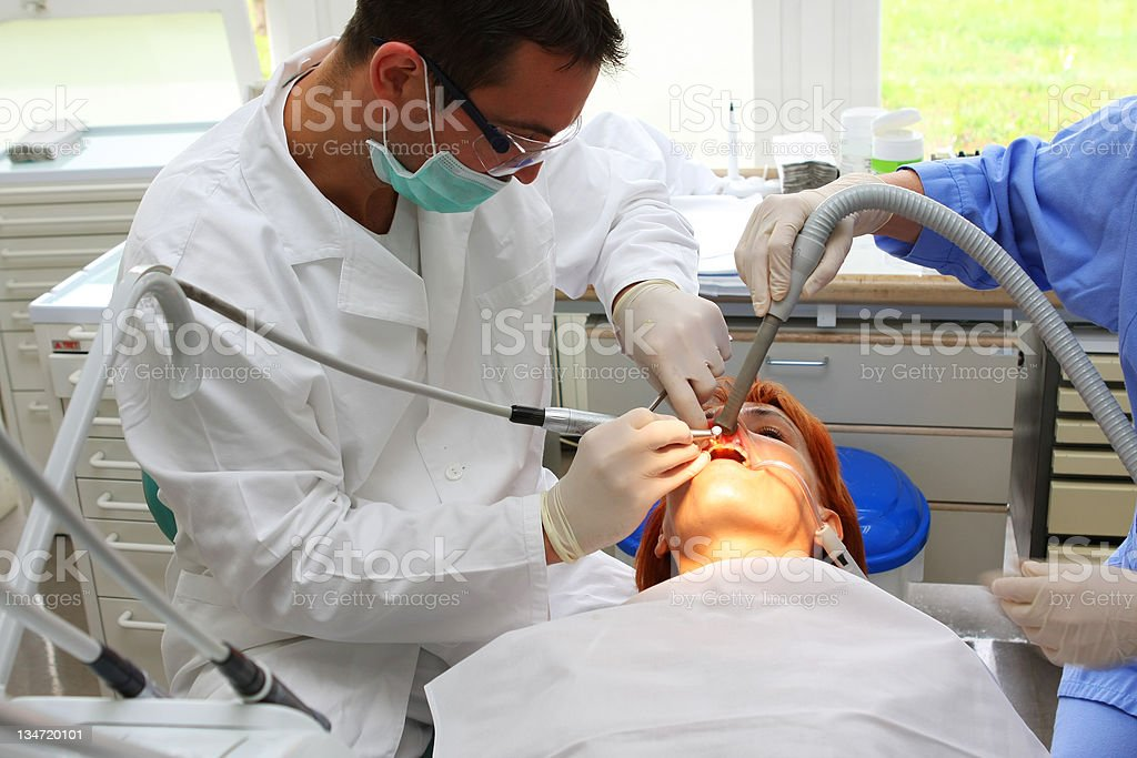 Pretty female at the dentist stock photo