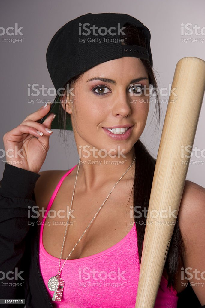 Pretty Female Baseball Lover Adjusts Hat Holding Wooden Bat stock photo