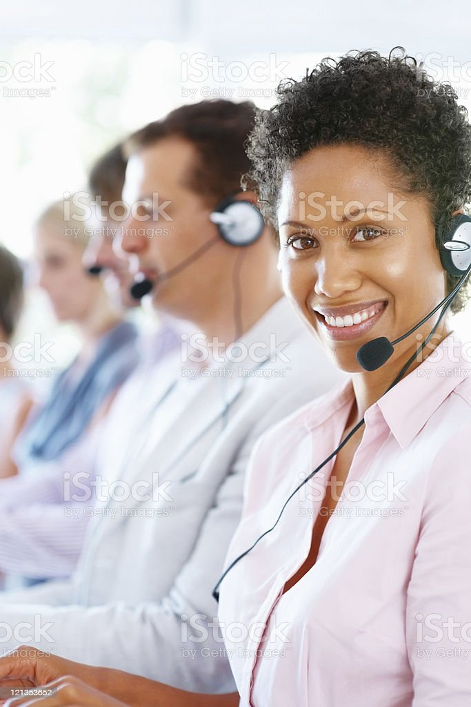 Pretty female call center executive royalty-free stock photo