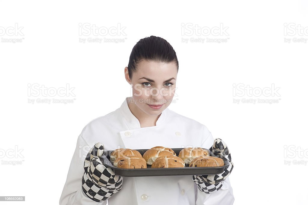 Pretty female chef with her fresh Hot Cross Buns royalty-free stock photo