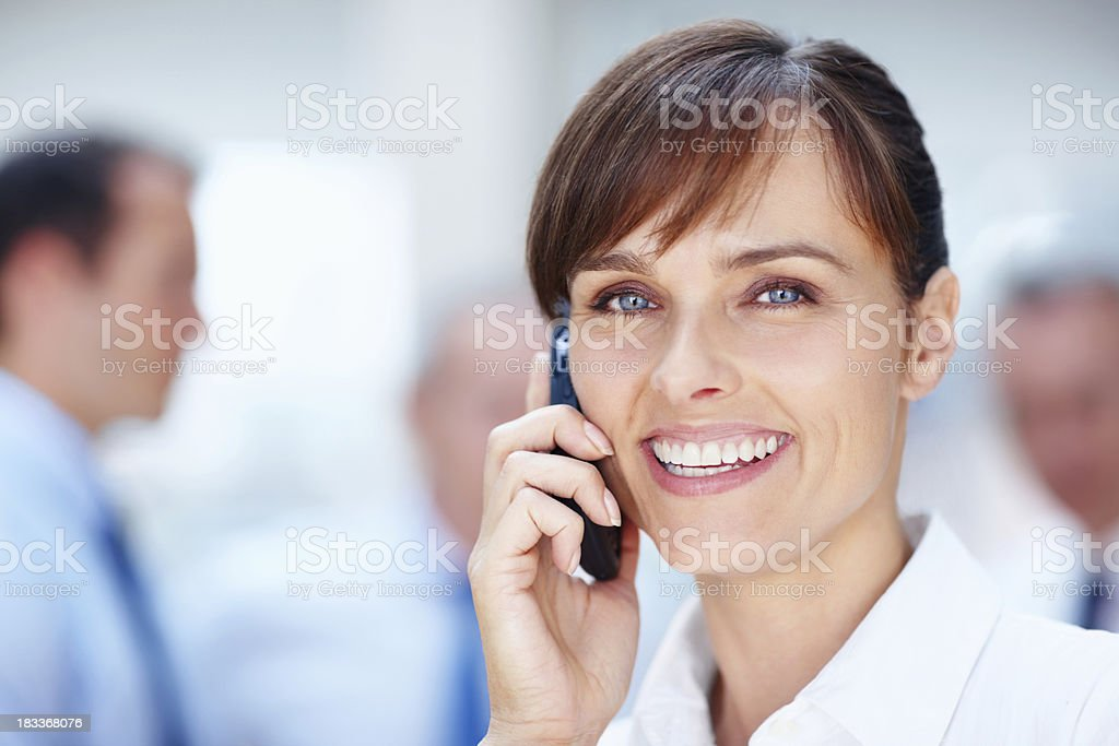 Pretty female executive on cell phone royalty-free stock photo
