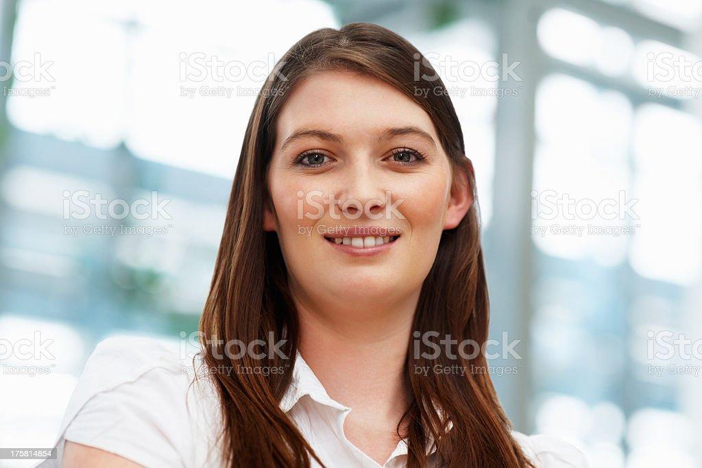 Pretty female executive smiling stock photo