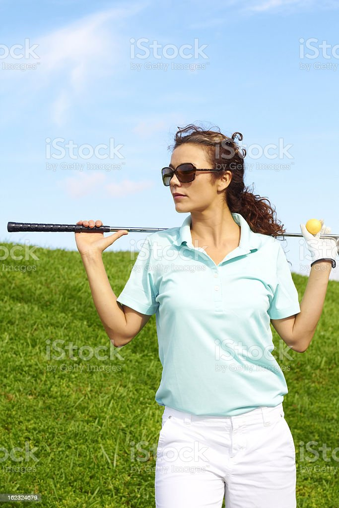 Pretty Female Golfer Relaxing royalty-free stock photo