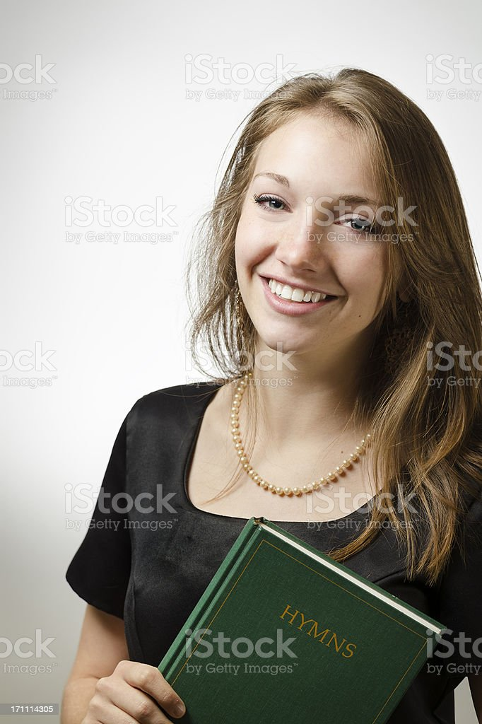 Pretty Female Holding a Hymn Book stock photo