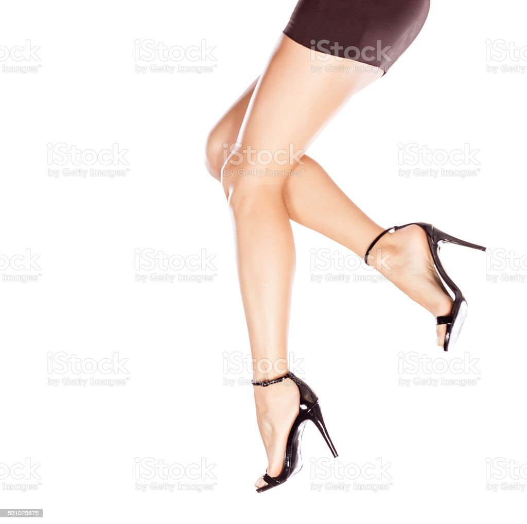 Pretty female legs in elegant sandals with high heels stock photo